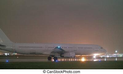 Passenger jet plane on a wet runway