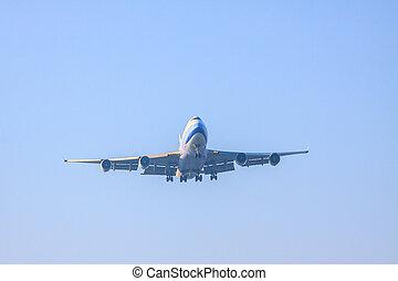 passenger jet plane preparing to landing on airport runways agai