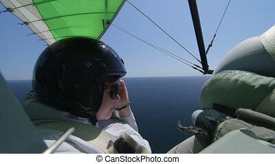 passenger of motorized hang glider - Female passenger in the...