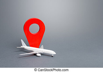 Passenger plane and red location indicator. Air travel. New rules for passengers transportation by air, quarantine measures. Support financial program for civil aviation in times of crisis downtime.