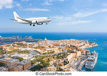 Passenger plane approach landing at Malta Valletta great bay with a cruise liner ship.