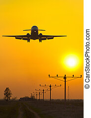 passenger plane at sunset