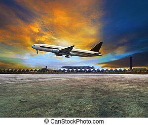 passenger plane flying above airpor