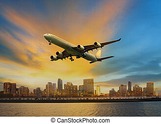 passenger plane flying above urban scene use for convenience air