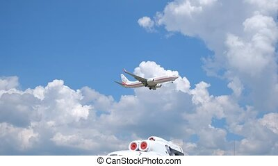 Passenger plane flying in the blue sky with white clouds