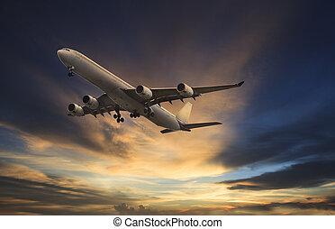 passenger plane flying on beautiful dusky sky