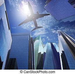 passenger plane flying ove rmodern office building against...