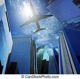 passenger plane flying over modern