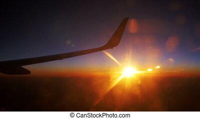 Passenger Plane in Flight Against a Background of Sunset