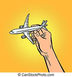passenger plane in hand. metaphor of travel and tourism