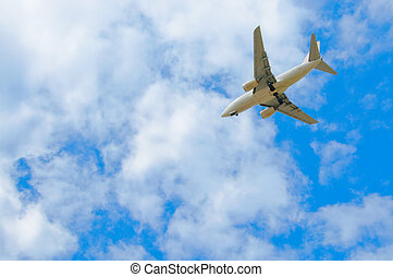 Passenger plane in the blue sky