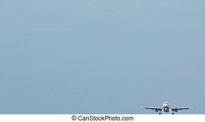 Passenger plane landing in the clear sky