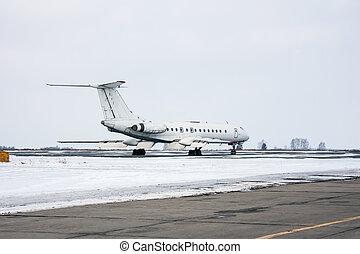 Passenger plane on the winter airport apron