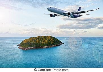 Passenger plane over tropical island