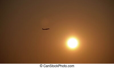 Passenger Plane Takes Off against the Background of the Sun ...