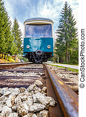 Passenger railway wagon from a low perspective from the rail.