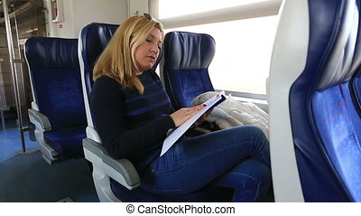 passenger reading magazine - attractive blonde women reading...