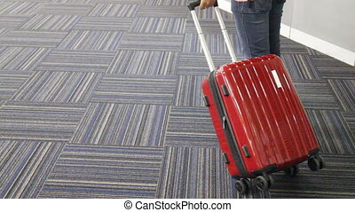Passenger rolling luggage in the airport, stock video