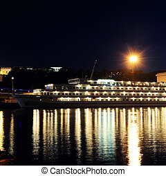 passenger ship at night in the harbor