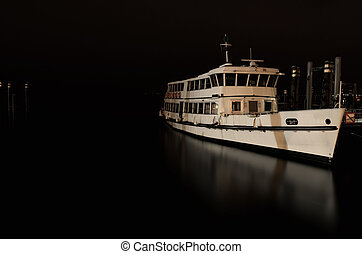 Passenger ship at night in the port