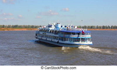 passenger ship floating in river