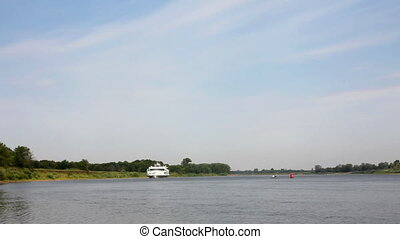 passenger ship floating on river