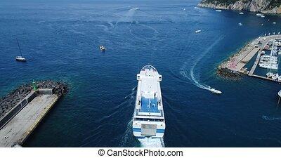 passenger ship in Capri harbor - flight over Capri harbor in...