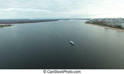 Passenger ship moving along the river