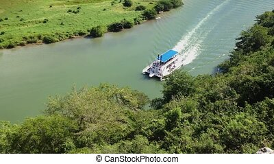 Passenger ship on a river in tropical forest