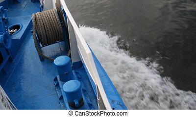 Passenger ship on river. - Waves following behind a ship.