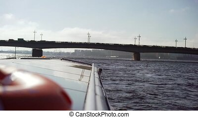Passenger ship sailing in a city river at sunny day