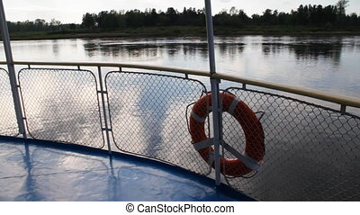 Passenger ship. - Ship floats. Fence of a deck on river...