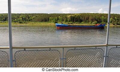 Passenger ship. - Ship floats. River banks.