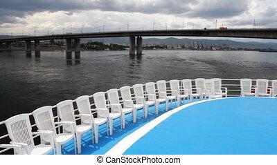 Passenger ship. - Bridge over Enisey river. Ship floats....