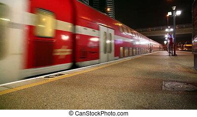 Passenger train arrives at the station.