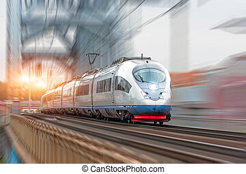 Passenger train follows the route at high speed