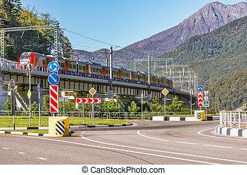 Passenger train from Sochi moves on the bridge.. Krasnaya Polyana.