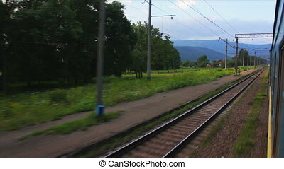 Passenger train goes to Carpathians (view from the train...
