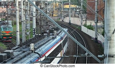 Passenger train going away - Passenger train passing by and...