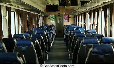 Passenger train inside with passengers in Vietnam.