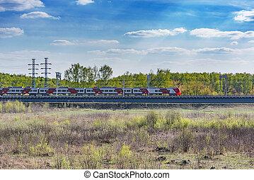 Passenger train moves on the bridge.