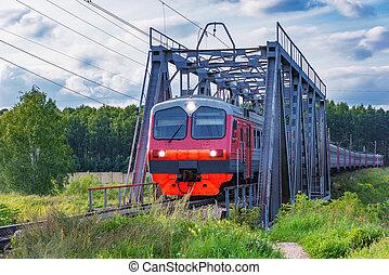 Passenger train moves through the bridge, Moscow region. Russia.