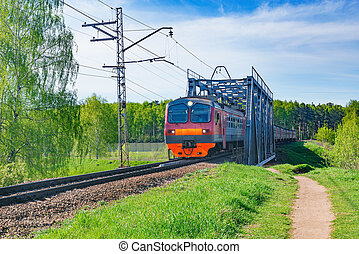 Passenger train moves through the bridge.
