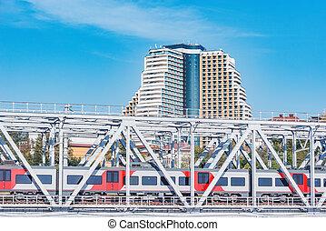 Passenger train moves through the bridge. Sochi..