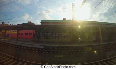 """Passenger train passing railway station, arrival at destination, industrial view"""