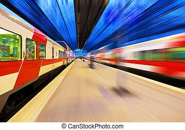 Passenger train passing railway station