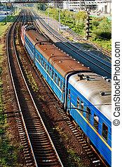 Passenger train rides on rails