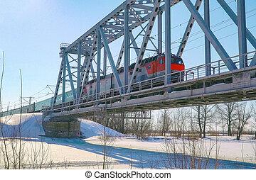 Passenger Train rides on the railway bridge