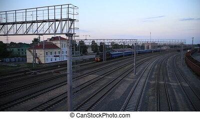 Passenger train rides the station, top view, railways