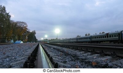 Passenger train stands at railway station before empty...